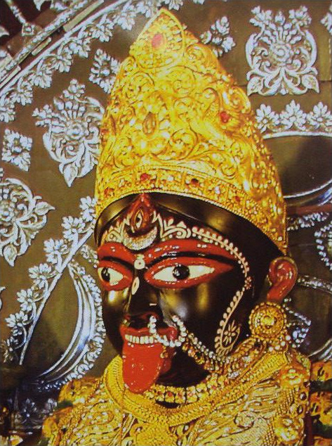 Kali - The white teeth of Kali represent conscience and the pressing red tongue represents greed.